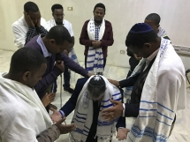 Ethiopia elders praying for director of Jacob's Hope Brent Johnson